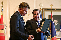 Pictured: (L-R) Mayor of Skopje Petre Silegov is presented with a gift by the Mayor of Athens Giorgos Kaminis hold a press conference. Friday 09 February 2018<br /> Re: Mayor of Athens Giorgos Kaminis and the Mayor of Skopje in the Former Yugoslav Republic of Macedonia, Petre Silegov have met at the Athens City Hall in Greece.
