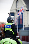 """Portsmouth 1 Southampton 1, 18/12/2012. Fratton Park, Championship. A mounted police officer on patrol in a street outside Fratton Park stadium before Portsmouth take on local rivals Southampton in a Championship fixture. Around 3000 away fans were taken directly to the game in a fleet of buses in a police operation known as the """"coach bubble"""" to avoid the possibility of disorder between rival fans. The match ended in a one-all draw watched by a near capacity crowd of 19,879. Photo by Colin McPherson."""