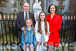 Lily Herlihy 6th class student in Derryquay NS receiving her Confirmation in St John's Church on Saturday. L to r: Ellen, Denis Herlihy and Brid Brosnan.