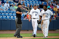 Lake County Captains David Wallace #37 and Bryson Myles #23 walk by umpire James Rackley during a game against the Fort Wayne TinCaps at Classic Park on July 2, 2012 in Eastlake, Ohio.  Fort Wayne defeated Lake County 5-4.  (Mike Janes/Four Seam Images)