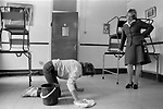 HM Prison Styal Wilmslow Cheshire UK 1980s. Womens prison, prison officer standing over female prisoner who is cleaning the floor.  Cheshire 1986 England