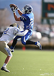 Carson's Colby Brown makes a reception against Reed's Daniel McCarthy during the NIAA D-1 Northern Regional title game at Bishop Manogue High School in Reno, Nev., on Saturday, Nov. 29, 2014. Reed won 28-25.<br /> Photo by Cathleen Allison