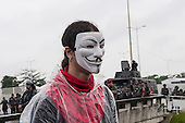 A demonstrator wearing an Occupy mask stands in the rain in front of army shock troops barring the way to the Riocentro United Nations conference during a demonstration by indigenous people, the Landless People's Movement (MST) and other civil society groups. The demonstrators are kept out of earshot and invisible to the UN conference. The United Nations Conference on Sustainable Development (Rio+20), Rio de Janeiro, Brazil, 20th June 2012. Photo © Sue Cunningham.