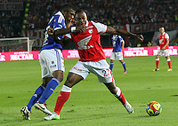 BOGOTA, COLOMBIA -ABPRIL 6: Marino García  (Right)  of Santa Fe struggles for the ball with  Elkin Blanco of Millonarios (left)during a match between Santa Fe and Millonarios  as part of the Liga Postobon I 2013 at Nemesio Camacho El Campin Stadium onApril 6 , 2013 in Bogota , Colombia. (Photo /VizzorImage /Felipe Caicedo /Staff)