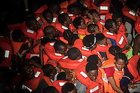 Sea Watch-2.<br /> Die Sea Watch-2 bei ihrer 13. SAR-Mission vor der libyschen Kueste.<br /> Im Bild: Ein in der Nacht gesichtetes Schlauchboot mit Gefluechteten wird von der Sea Watch-Crew geborgen. Das Schlauchboot ist mit ca. 160 Menschen total ueberfuellt.<br /> 22.10.2016, Mediterranean Sea<br /> Copyright: Christian-Ditsch.de<br /> [Inhaltsveraendernde Manipulation des Fotos nur nach ausdruecklicher Genehmigung des Fotografen. Vereinbarungen ueber Abtretung von Persoenlichkeitsrechten/Model Release der abgebildeten Person/Personen liegen nicht vor. NO MODEL RELEASE! Nur fuer Redaktionelle Zwecke. Don't publish without copyright Christian-Ditsch.de, Veroeffentlichung nur mit Fotografennennung, sowie gegen Honorar, MwSt. und Beleg. Konto: I N G - D i B a, IBAN DE58500105175400192269, BIC INGDDEFFXXX, Kontakt: post@christian-ditsch.de<br /> Bei der Bearbeitung der Dateiinformationen darf die Urheberkennzeichnung in den EXIF- und  IPTC-Daten nicht entfernt werden, diese sind in digitalen Medien nach §95c UrhG rechtlich geschuetzt. Der Urhebervermerk wird gemaess §13 UrhG verlangt.]