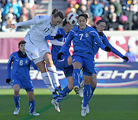 US forward Abby Wambach (17) heads a shot on goal in traffic.  The U.S. Women's National Team defeated Italy 1-0 at Toyota Park in Bridgeview, IL on November 27, 2010 to advance to the Women's World Cup in Germany.