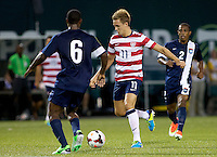 PORTLAND, Ore. - July 9, 2013: Stuart Holden controls the ball in the second half. The US Men's National team plays the National team of Belize during the 2013 Gold Cup at at JELD-WEN Field.