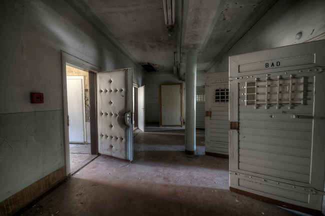Abandoned Stasi prison <br /> This part of the prison is what I think would be the medical part, as the on the one door it was written dentist another few doors was bath and another waiting room and this door with heavy padding, which is very common in the DDR as sound proofing, why its has sound proofing here I have no idea. Very creepy