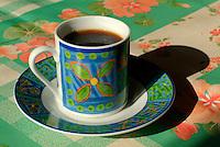 Coffee in a brightly decorated ceramic mug.
