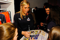 Washington Freedom player Allie Long signs autographs after the unveiling of the Women's Professional Soccer uniforms at the Event Place in Manhattan, NY, on February 24, 2009. Photo by Howard C. Smith/isiphotos.com