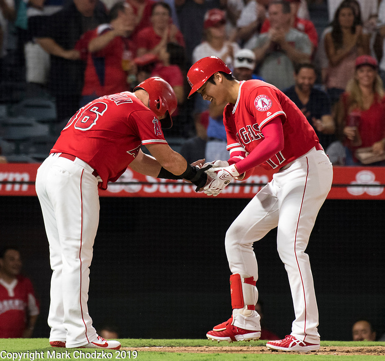 L.A. Angels Kole Calhoun congratulates Shohei Ohtani on his home run.