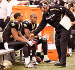 December 2009: New Orleans head coach Sean Payton, right, talks to WR Marques Colston, center, and WR Robert Meachem, left,  during an NFL football game at the Louisiana Superdome in New Orleans.  The Buccaneers defeated the Saints 20-17.