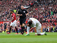 Pictured: Ashley Williams (R) injured on the ground. Sunday 12 May 2013<br /> Re: Barclay's Premier League, Manchester City FC v Swansea City FC at the Old Trafford Stadium, Manchester.
