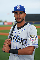 Biloxi Shuckers third baseman Yadiel Rivera (13) poses for a photo before the second game of a double header against the Pensacola Blue Wahoos on April 26, 2015 at Pensacola Bayfront Stadium in Pensacola, Florida.  Pensacola defeated Biloxi 2-1.  (Mike Janes/Four Seam Images)