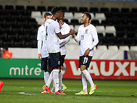 Pictured: Nathan Redmond of England (R) celebrating his third goal. Monday 19 May 2014<br />