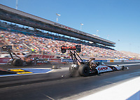 Oct 26, 2018; Las Vegas, NV, USA; NHRA top fuel driver Steve Torrence (right) races alongside Clay Millican during qualifying for the Toyota Nationals at The Strip at Las Vegas Motor Speedway. Mandatory Credit: Mark J. Rebilas-USA TODAY Sports