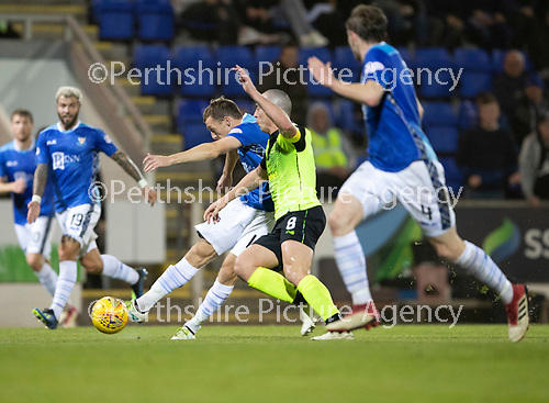 St Johnstone v Celtic…26.09.18…   McDiarmid Park     BetFred Cup Quarter Final<br />David McMillan has a shot at goal despite Scott Brown's tackle<br />Picture by Graeme Hart. <br />Copyright Perthshire Picture Agency<br />Tel: 01738 623350  Mobile: 07990 594431