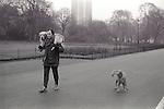 Man walking with dog Hyde Park London UK
