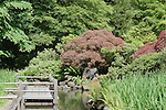 Deck Over Koi Pond and Iris Garden, Portland, Oregon, Japanese GardenThe Japanese Garden in Portland is a 5.5 acre respit.  Said to be one of the most authentic Japanese Garden's outside of Japan, the rolling terrain and water features symbolize both peace and strength.