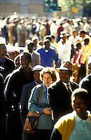 Voters queue at dawn at a polling station north of Pretoria on the day of the country's first democratic multiracial election.