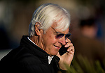 ARCADIA, CA - APRIL 21: Trainer Bob Baffert takes a phone call after Justify completes a workout for the Kentucky Derby at Santa Anita Park on April 21, 2018 in Arcadia, California. (Photo by Alex Evers/Eclipse Sportswire/Getty Images)