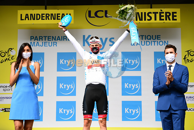 Tadej Pogacar (SLO) UAE Team Emirates wears the first young riders White Jersey at the end of Stage 1 of the 2021 Tour de France, running 197.8km from Brest to Landerneau, France. 26th June 2021.  <br /> Picture: A.S.O./Pauline Ballet | Cyclefile<br /> <br /> All photos usage must carry mandatory copyright credit (© Cyclefile | A.S.O./Pauline Ballet)