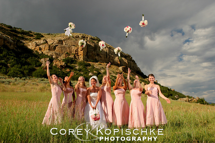 Bridesmaids tossing their bouquets all together during photo session.