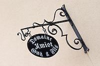 wrought iron sign domaine g amiot & f chassagne-montrachet cote de beaune burgundy france