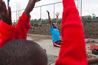 Roof top yoga for girls in Kibera, east Africa's largest slum, at Shining Hope School.