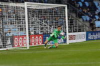 SAINT PAUL, MN - MAY 12: Tyler Miller #1 of Minnesota United FC with a save during a game between Vancouver Whitecaps and Minnesota United FC at Allianz Field on May 12, 2021 in Saint Paul, Minnesota.