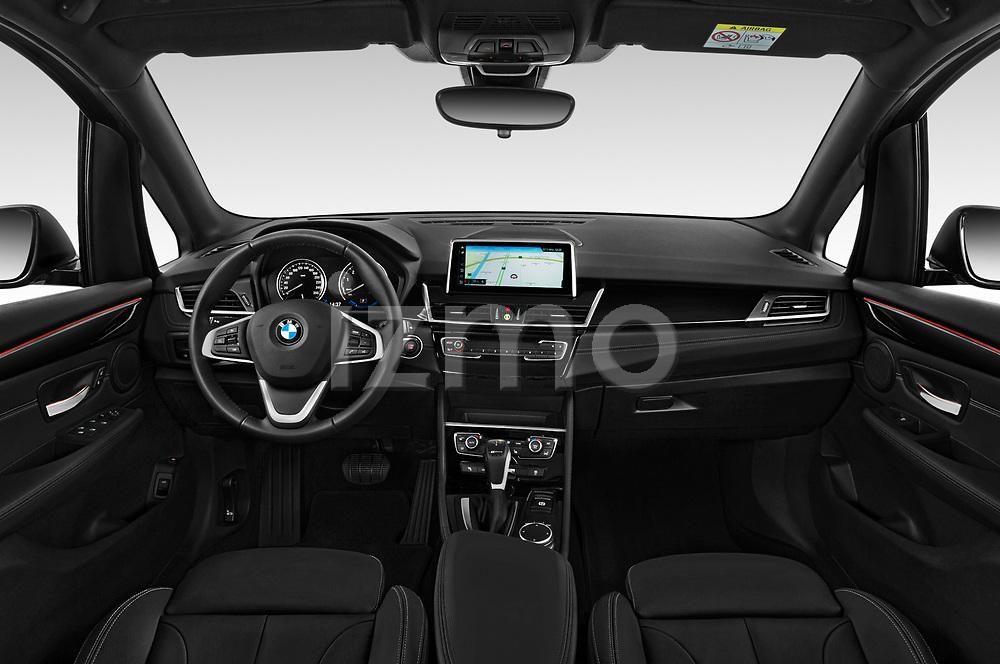 Stock photo of straight dashboard view of a 2018 BMW 2 Series 225xe iperformance 5 Door Mini Van