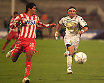 UNAM Pumas forward Bruno Marioni (R) battles for the ball against Necaxa Rayos defender  Luis Omar Hernandez during their soccer match at the Olympic Stadium in Mexico City, February 1, 2006. UNAM tied 0-0 to Necaxa. Photo by Heriberto Rodriguez