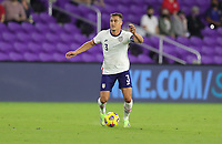 ORLANDO CITY, FL - JANUARY 31: Aaron Long #3 of the United States passes off the ball during a game between Trinidad and Tobago and USMNT at Exploria stadium on January 31, 2021 in Orlando City, Florida.