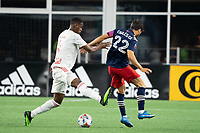 FOXBOROUGH, MA - MAY 22: Andres Reyes #4 of New York Red Bulls tackles Carles Gil #22 of New England Revolution during a game between New York Red Bulls and New England Revolution at Gillette Stadium on May 22, 2021 in Foxborough, Massachusetts.