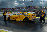 May 20, 2011; Topeka, KS, USA: NHRA funny car driver Jeff Arend is directed to stage by crew members during qualifying for the Summer Nationals at Heartland Park Topeka. Mandatory Credit: Mark J. Rebilas-