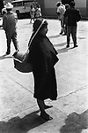 San Cristobal de las Casas  Mexico. Market day 1970s woman head carrying water bottle or similar large pot from a straps across her head. 1973. Mexican state of Chipas