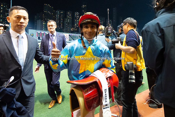 Happy Valley, Hong Kong - December 4:Dream Warriors, Karis Teetan & Connections after the win in the Longines International Jockey' Championship Handicap second leg at Happy Valley Racecourse in Hong Kong. Michael McInally/Eclipse Sportswire/CSM