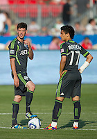Seattle Sounders FC midfielder Brad Evans #3 and Seattle Sounders FC forward Fredy Montero #17 getting ready to begin an MLS game between the Seattle Sounders FC and the Toronto FC at BMO Field in Toronto on June 18, 2011..The Seattle Sounders FC won 1-0.