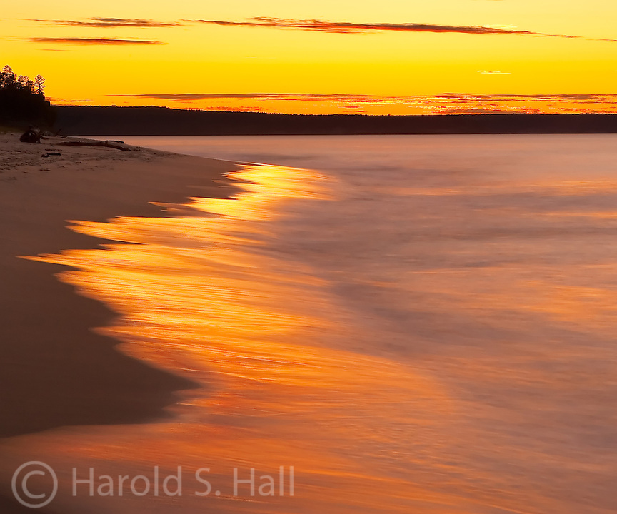 A golden sunset on Lake Superior near Munising, Michigan.