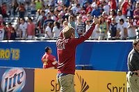 Chicago, IL - Sunday July 28, 2013:   The USMNT head coach Jurgen Klinsmann celebrates with his players and waves to fans during the CONCACAF Gold Cup Trophy ceremony, after defeating Panama by the score of 1-0 during the CONCACAF Gold Cup Finals soccer match between the USMNT and Panama, at Soldier Field in Chicago, IL.