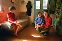 Belarus/Weissrussland, 2005<br /> KUZKAVITCHI. Elena Kosiakova (26), mother of three children is living in the village of Kuskavitchi some 20 km from the small town Bykhov in the Mogilev region (Belarus). This region was heavily contaminated by radioactive fallout after the Chernobyl disaster. The village Kuskavitchi was contaminated up to 15 Curie per square kilometer. According to Western standards this village should be evacuated immediately. Elena lives of some 220 000 Belorussian rubles (100 US dollars) per month, which she gets from the social services of the government. Despite of the lack of money she has adopted two more children, because their parents were not able to provide for them.<br /> ? Vaclav Vasku/EST&OST