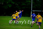Annascaul's Gearoid Lyne takes possession in the air as Aidan Breen of Ballymac tackles him in Division 2b of the County Football League