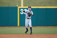 Chris Givin (35) of the Xavier Musketeers makes a throw to first base against the Penn State Nittany Lions at Coleman Field at the USA Baseball National Training Center on February 25, 2017 in Cary, North Carolina. The Musketeers defeated the Nittany Lions 10-4 in game one of a double header. (Brian Westerholt/Four Seam Images)