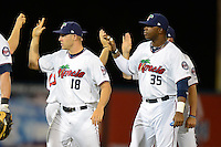 Fort Myers Miracle pitcher Chad Rodgers #18 and Kennys Vargas #35 high five teammates after a game against the Jupiter Hammerheads on April 9, 2013 at Hammond Stadium in Fort Myers, Florida.  Fort Myers defeated Jupiter 1-0.  (Mike Janes/Four Seam Images)