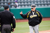 Wichita State Shockers head coach Gene Stephenson talks with the home plate umpire during a game against the Missouri State Bears at Hammons Field on May 5, 2013 in Springfield, Missouri. (David Welker/Four Seam Images)
