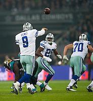 09.11.2014.  London, England.  NFL International Series. Jacksonville Jaguars versus Dallas Cowboys. Cowboys' Tony Romo (#9) passes to Dallas Cowboys' Running Back DeMarco Murrey (#29)