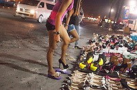 A prostitute tries on an new pair of high-heel shoes in Angeles City, Republic of the Philippines, 08 November 2014. The 'sin city', which sprung up on the fringes of a US Air Force base during the Vietnam war, has a reputation for cheap sex, and was a favourite destination for alleged murderer Rurik Jutting, who used to fly to Angeles City from Hong Kong for debauched weekends. The British banker is currently on remand at a secure facility in Hong Kong for allegedly murdering two Indonesian prostitutes in his flat whilst high on alcohol and cocaine.