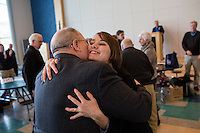 People greet Shenna Bellows, Democratic candidate in Maine for US Senate, after she spoke to the Falmouth Democratic town caucus in the Falmouth Elementary School cafeteria in Falmouth, Maine, USA, on March 3, 2014. Bellows is trying to unseat incumbent Maine Republican Senator Susan Collins in the 2014 election. The town caucus had speeches from various other local candidates and also served to choose delegates for the 2014 Maine State Democratic Caucus.