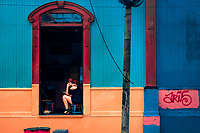 A Salvadoran sex worker looks at the phone screen while waiting for clients in a street sex bar in San Salvador, El Salvador, 12 April 2018. Although prostitution is not legal in El Salvador, dozens of street sex workers, wearing provocative miniskirts, hang out in the dirty streets close to the capital's historic center. Sex workers of all ages are seen on the streets but a significant part of them are single mothers abandoned by their male partners. Due to the absence of state social programs, they often seek solutions to their economic problems in sex work. The environment of street sex business is strongly competitive and dangerous, closely tied to the criminal networks (street gangs) that demand extortion payments. Therefore, sex workers employ any tool at their disposal to struggle hard, either with their fellow workers, with violent clients or with gang members who operate in the harsh world of street prostitution.
