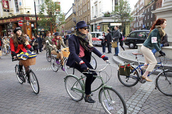 Mark-Francis Vandelli and Gabilicious from Made in Chelsea set off on their bicycles for The Tweed Run, London